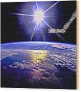 Robot Arm Over Earth With Sunburst  Wood Print