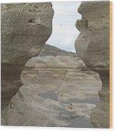 Rock Caves On The Beach Wood Print