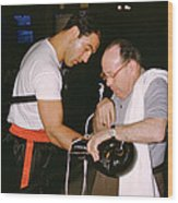 Rocky Marciano Looking At Glove Wood Print by Retro Images Archive