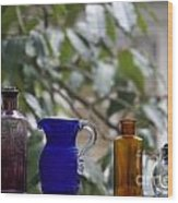 Row Of Colorful Glass Bottles  Wood Print