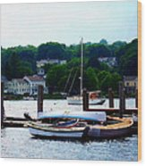 Rowboats Piled At Dock Wood Print