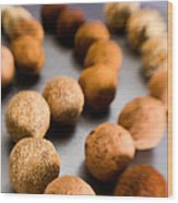 Rows Of Chocolate Truffles On Silver Wood Print