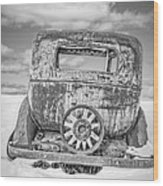 Rusty Old Car In The Snow Wood Print