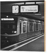s-bahn train speeding through unter den linden underground station Berlin Germany Wood Print