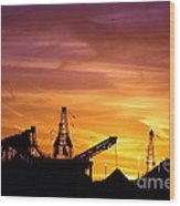 Sand Pit Silhouette  Sunset With Red And Yellow Sky Wood Print