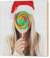 Santa Girl Eating Lollipop Wood Print