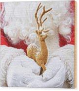 Santa Holding Reindeer Figure Wood Print