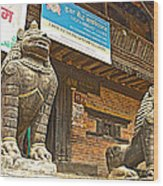 Sculptures Of Protector Figures In Front Of Sufata Buddhist College In Patan Durbar Square Wood Print