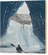 Sea Kayaker Paddles Through An Ice Cave Wood Print