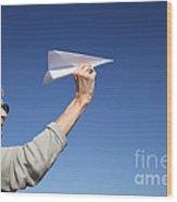 Senior Woman With Paper Plane Wood Print