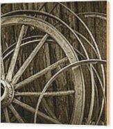 Sepia Photo Of Broken Wagon Wheel And Rims Wood Print