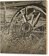 Sepia Toned Photo Of An Old Broken Wheel Of A Farm Wagon Wood Print
