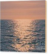 Setting Sun At Sea Wood Print