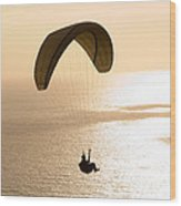 Silhouette Of A Paraglider Flying Wood Print