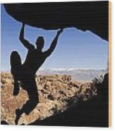 Silhouette Of A Rock Climber Wood Print