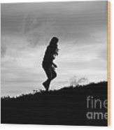 Silhouette Of Girl Running Wood Print