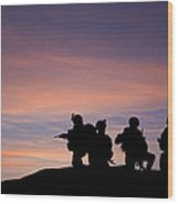 Silhouette Of Modern Troops In Middle East Silhouette Against Be Wood Print by Matthew Gibson