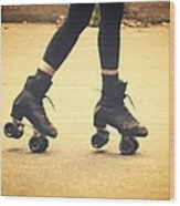 Skates In Motion Wood Print