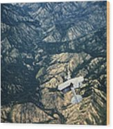 Small Plane Flying Over Mountains Wood Print