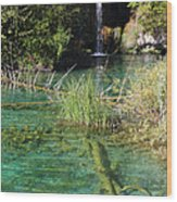 Small Waterfall And An Emerald Colored Lake Wood Print