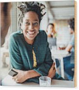 Smiling Businesswoman Sitting With Colleague In Cafeteria Wood Print