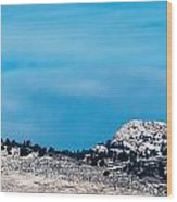 Snow-capped Horsetooth Rock Wood Print by Harry Strharsky