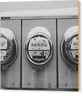 snow covered electricity meters in Saskatoon Saskatchewan Canada Wood Print by Joe Fox