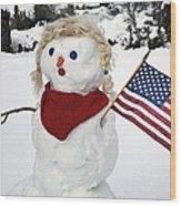 Snow Woman With Flag Wood Print