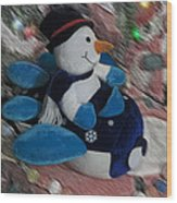 Snowman And His Speeding Plane Wood Print