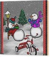Snowmen Playing Wood Print