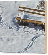 Snowy Foot Prints Around Snow Covered Park Bench Wood Print