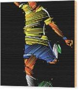 Soccer Player Running To Kick The Ball Wood Print