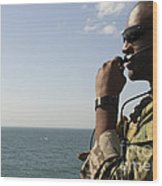 Soldier Instructs Small Boat Maneuvers Wood Print