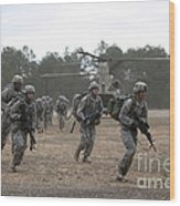 Soldiers Exit A Ch-47 Chinook Wood Print