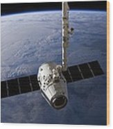 Spacex Dragon Capsule At The Iss Wood Print