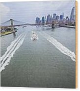 Speed Boats And Barge At East River In Front Of The Brooklyn Bridge And Manhattan Skyline Wood Print