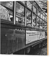 St. Charles Ave Streetcar Whizzes By-black And White Wood Print