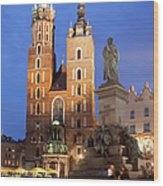 St Mary Basilica And Adam Mickiewicz Monument At Night In Krakow Wood Print