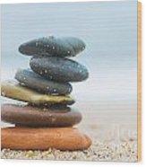 Stack Of Beach Stones On Sand Wood Print by Michal Bednarek