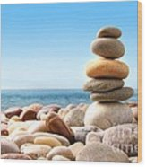 Stack Of Pebble Stones On White Wood Print by Sandra Cunningham
