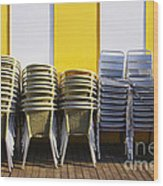 Stacks Of Chairs And Tables Wood Print by Carlos Caetano