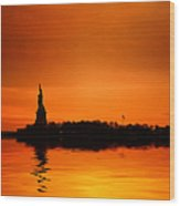 Statue Of Liberty At Sunset Wood Print by John Farnan