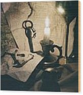 Still Life With Bones Rusty Key Wine Glass Lit Candle And Papers Wood Print