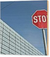 Stop Sign And Building In The Background Wood Print
