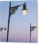 Street Lamps Over Sunset Sky Background Wood Print