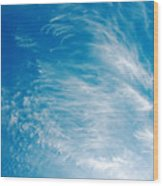 Strong Winds Forming Cirrus Clouds With A Deep Blue Sky. Wood Print