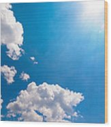 Sun Burst On A Blue Sky And Clouds Wood Print