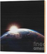 Sun Rising From Behind Planet Earth Outline Wood Print