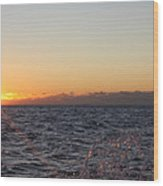 Sun Rising Through Clouds In Rough Waters Wood Print by John Telfer