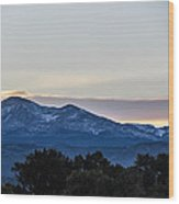 Sun Setting Behind The Mountains Wood Print